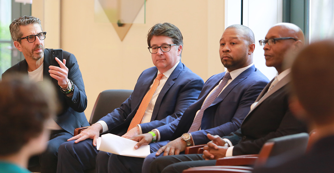 Jason Flom, attorney Dean Strang '85, attorney Jarrett Adams and clinic client Darnell Phillips
