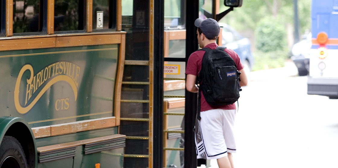 A student boards the trolley