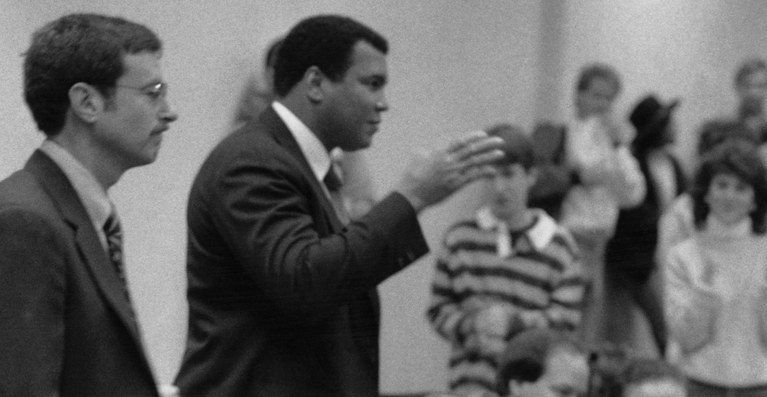 Boxing legend Muhammad Ali visits then-Professor Stephen A. Saltzburg's Criminal Procedure class in 1988 to discuss U.S. v. Clay. The Supreme Court case centered on Ali, formerly known as Cassius Clay, and his failure to report for military service during the Vietnam War on conscientious objector grounds.