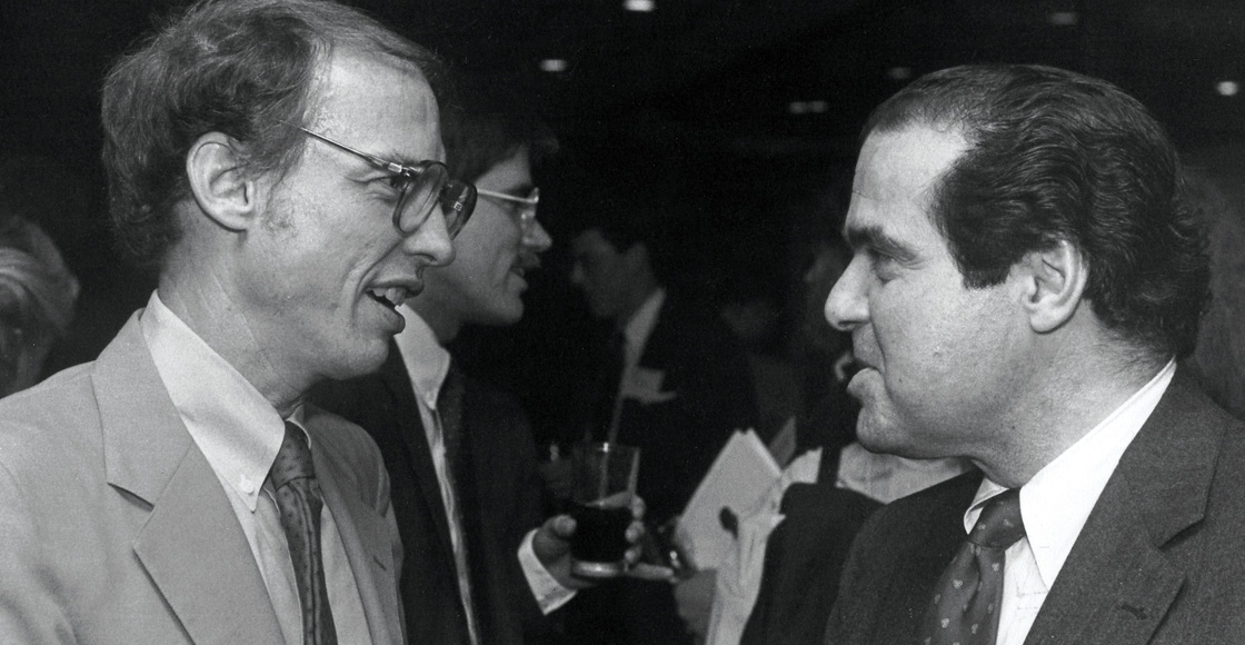 J. Harvie Wilkinson III '72 of the U.S. Court of Appeals for the Fourth Circuit chats with U.S. Supreme Court Justice Antonin Scalia at the Federalist Society symposium in 1988. Perhaps they were comparing notes as former UVA Law professors?