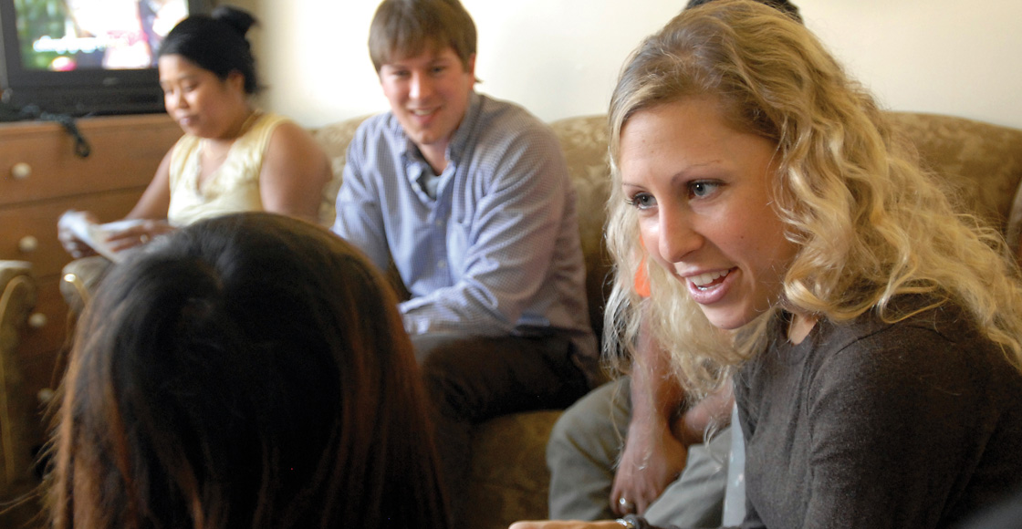 Rebecca Vallas '09, who served as president of the Public Interest Law Association and as a Skadden Fellow after graduation, talks with clients in 2009.