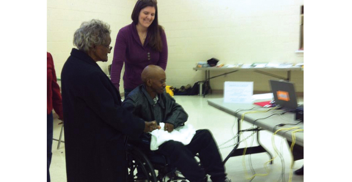 Innocence Project Clinic student Alexandra Meador '14 accompanies client Bennett Barbour to the polls in November 2012 as he votes for the first time, after he was exonerated with help from the clinic. Barbour died just two months later of bone cancer.