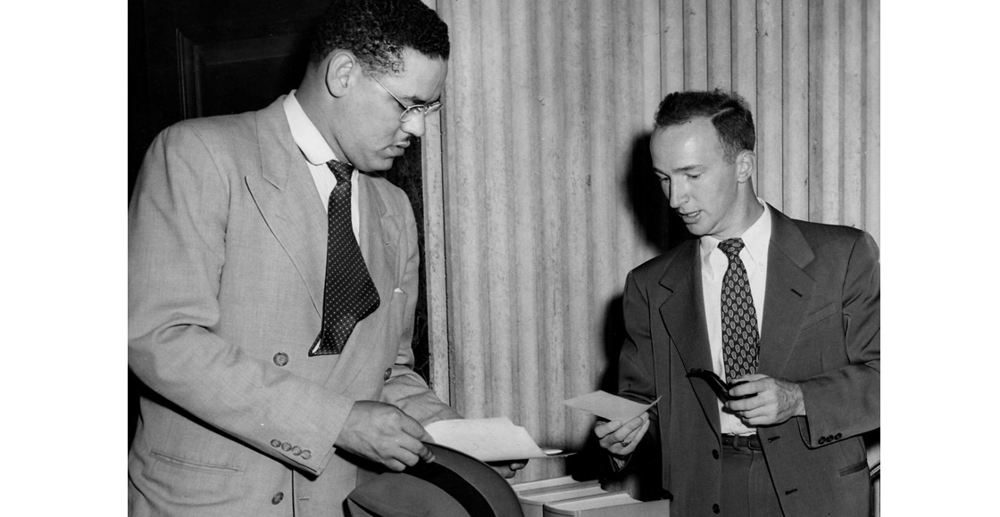 Gregory H. Swanson '51 consults with Assistant Law Dean Charles Woltz after registration on Sept. 15, 1950.