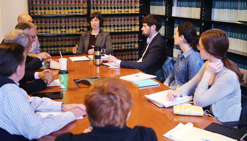 Angela Ciolfi '03 a legal director at Legal Aid Justice Center's Charlottesville office, talks strategy with the Drive Down the Debt team, which includes alumni and current students.