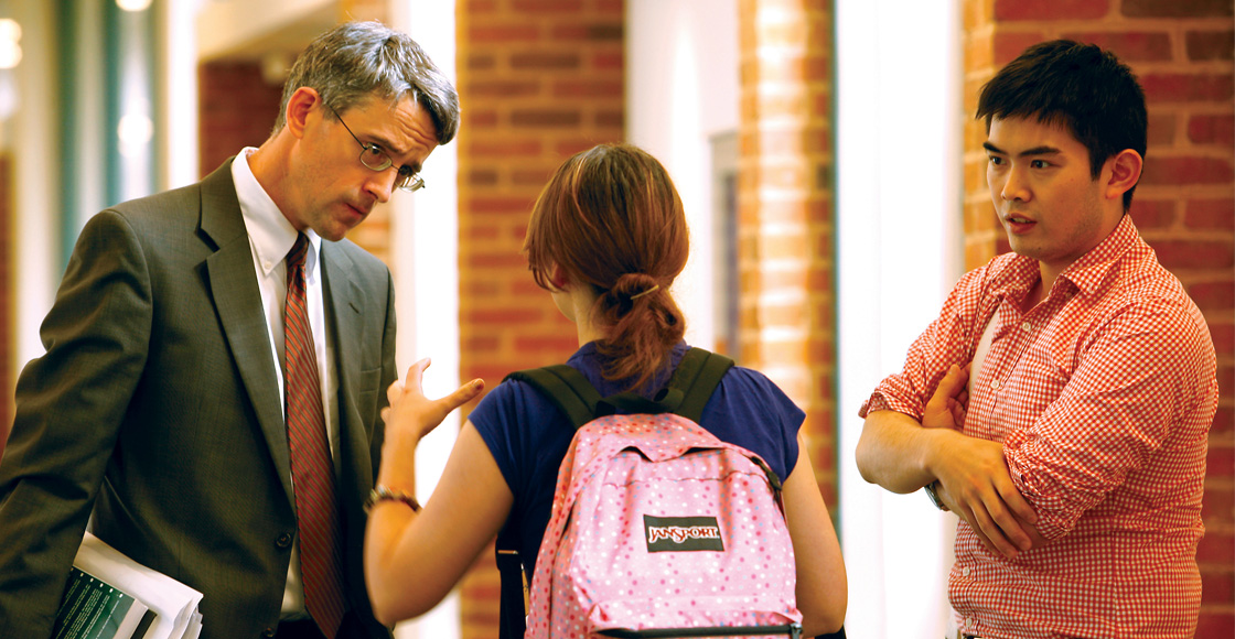 Professor Caleb Nelson talks to two law students after class in the fall of 2011.
