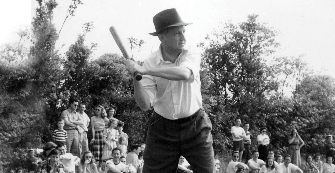 Dean F.D.G. Ribble '21 plays softball with students and faculty in the early 1950s.