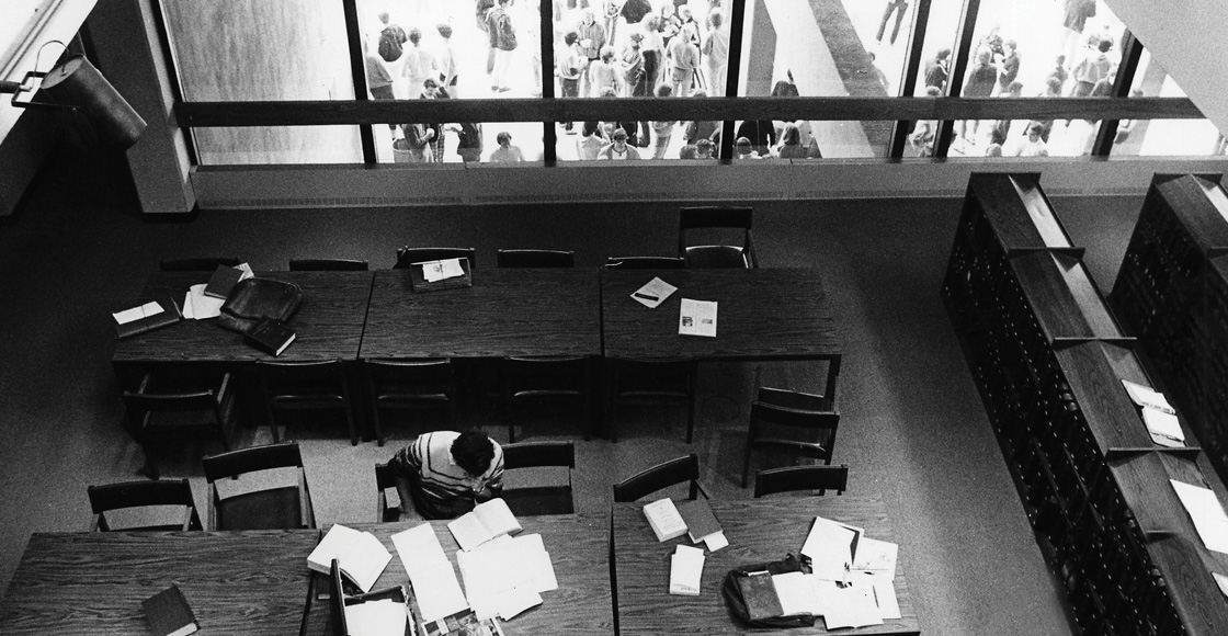 A student studies in the original library on North Grounds.