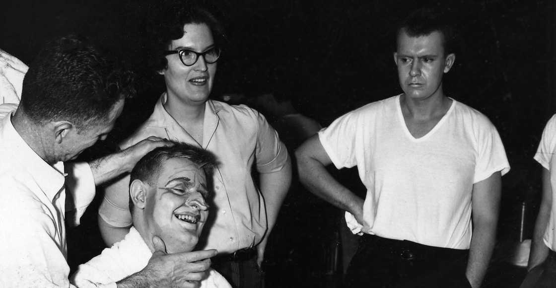 A student puts makeup on for the Libel Show in 1961.