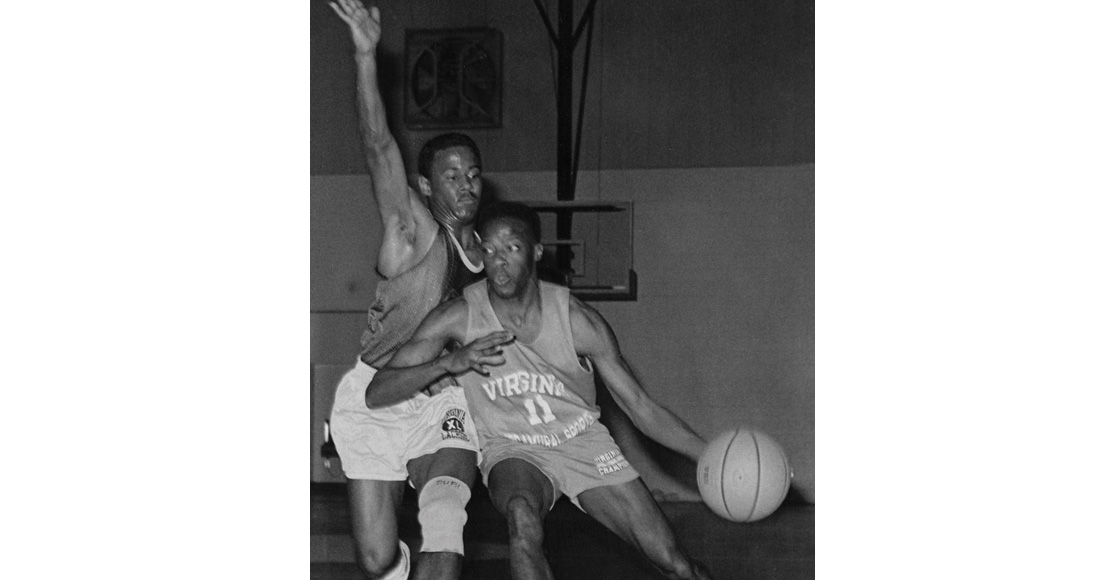 In the 1989 finals of the Law School Section Basketball Tournament, Ken Wheeler '91 (11) attempts to drive past Julian Brown '91.