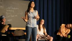Emily Davidson '18 expresses her feelings in a classroom skit.