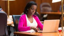 UVA Law student studies in the library