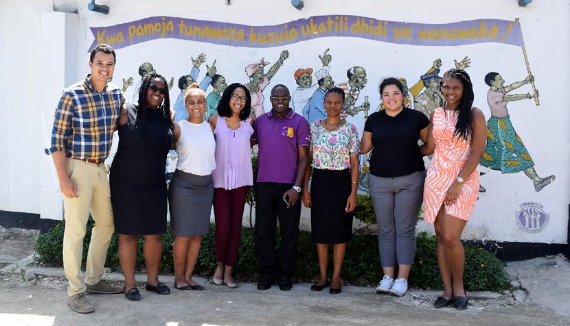 Law students Joe Charlet, Toccara Nelson, Nel-Sylvia Guzman and Kierstin Fowler; two of their supervisors; and law students Devyne Byrd and Lola Akere stand in front of the Women's Legal Aid Center in Tanzania, where they volunteered over the break.