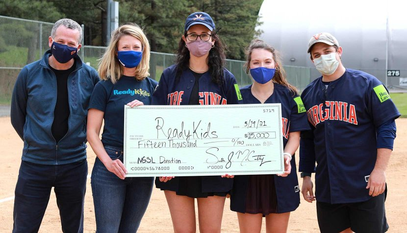 NGSL players presenting a check