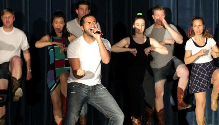 Students dance in the libel show.