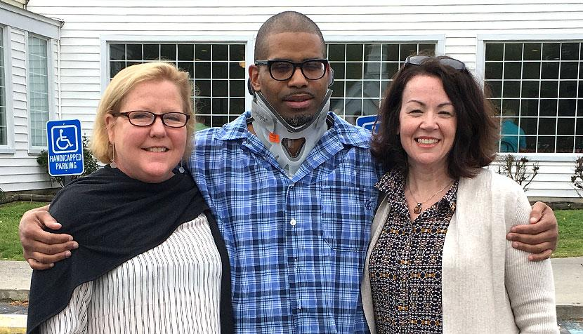 Messiah Johnson poses with Innocence Project Clinic directors Deirdre Enright and Jennifer Givens
