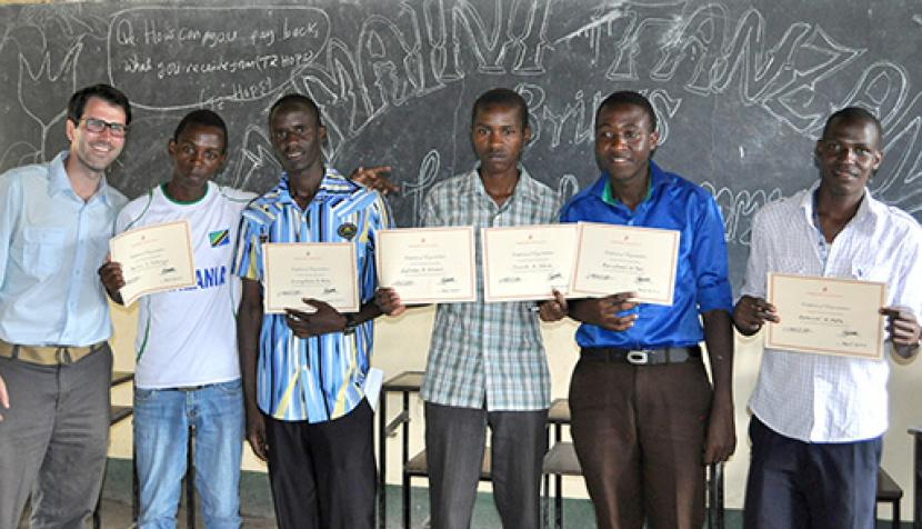 Lide Paterno and five Tanzanian students celebrate their graduation from secondary school.