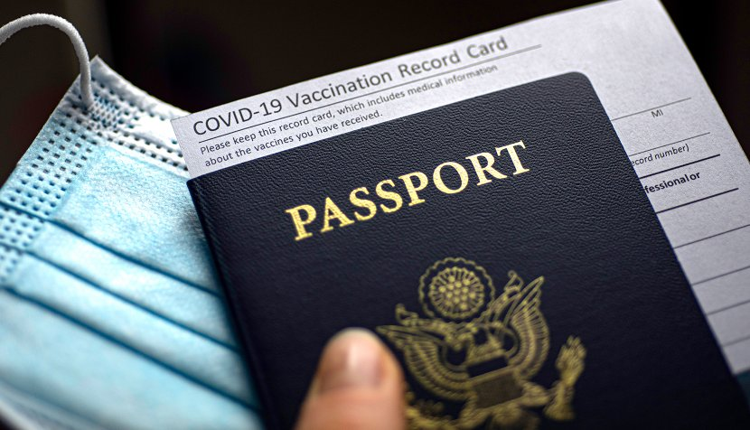 A mask, vaccination card and passport