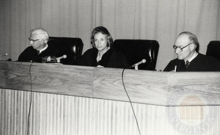 Judge Paul H. Roney of the U.S. Court of Appeals for the Eleventh Circuit, Justice Sandra Day O'Connor of the U.S. Supreme Court and Judge Louis F. Oberdorfer of the U.S. District Court for the District of Columbia hear arguments during the Moot Court finals in 1985.