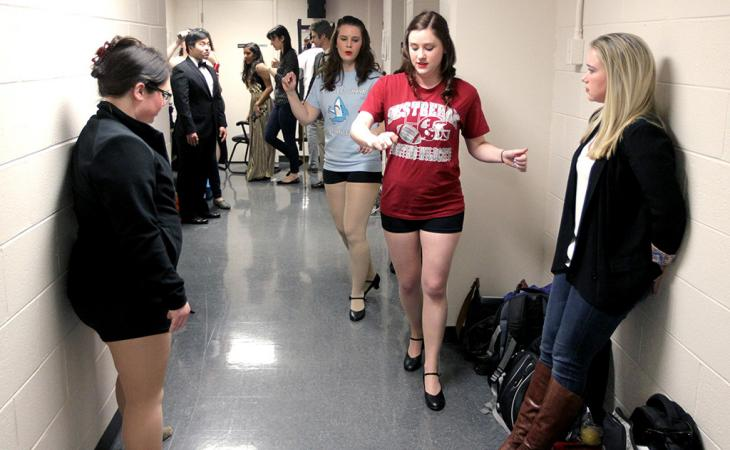 Students gather in a hallway.