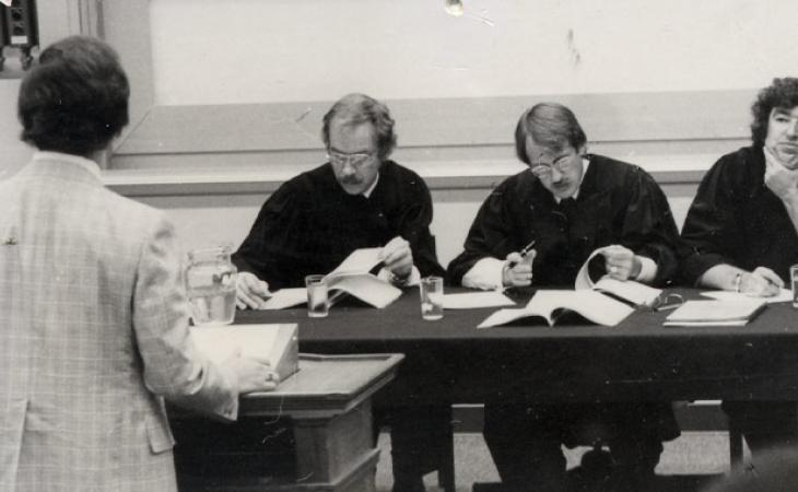 Low (far right) judges a moot court quarterfinal round in 1975.