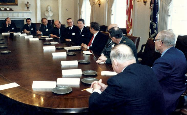 In the cabinet room at the White House, Moore and his fellow chairmen of the United States Institute of Peace converse with President Ronald Reagan.