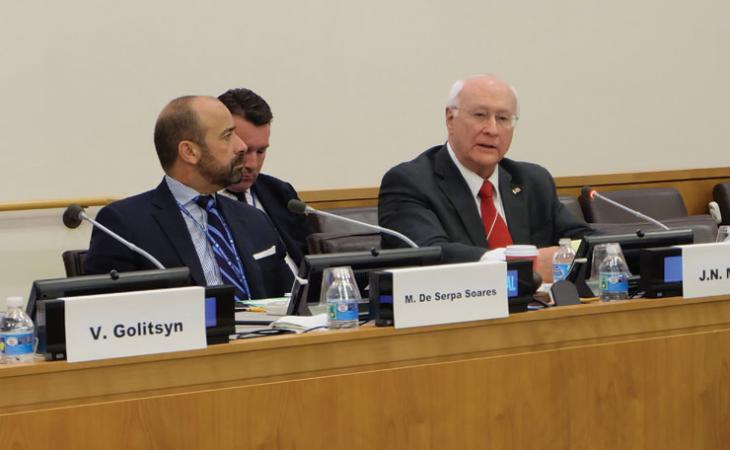 Moore, right, sits on a panel