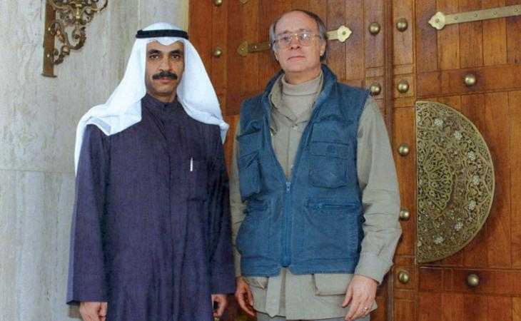 Sheikh Saud Nasser al-Sabah, Kuwait's ambassador to the United States, stands with Moore