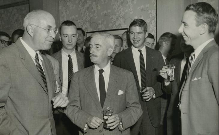 Authors William Faulkner, center, and John Dos Passos, left, at a reception in 1957 following a Jefferson Society lecture delivered by Dos Passos.