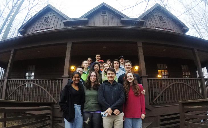 Students in front of cabin