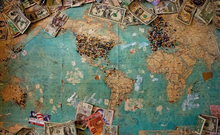 World map with money and pushpins