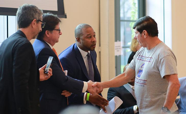 Freed client Emerson Stevens shakes hands with attorney Dean Strang '85.