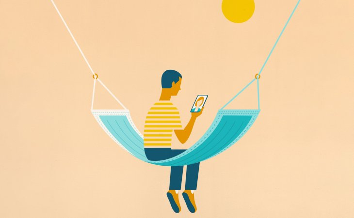 Man looks at phone on a hammock shaped like a mask