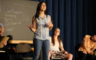 A student rehearses a performance