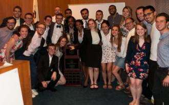 UVA mock trial team stands with their coaches