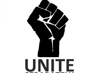 "Graphic closed fist with text that reads ""Introverts Unite Separately in Your Own Homes"""