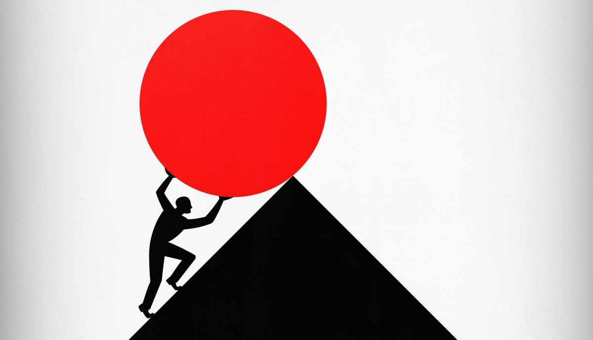 An illustration of a person pushing a circular object up a triangular hill.