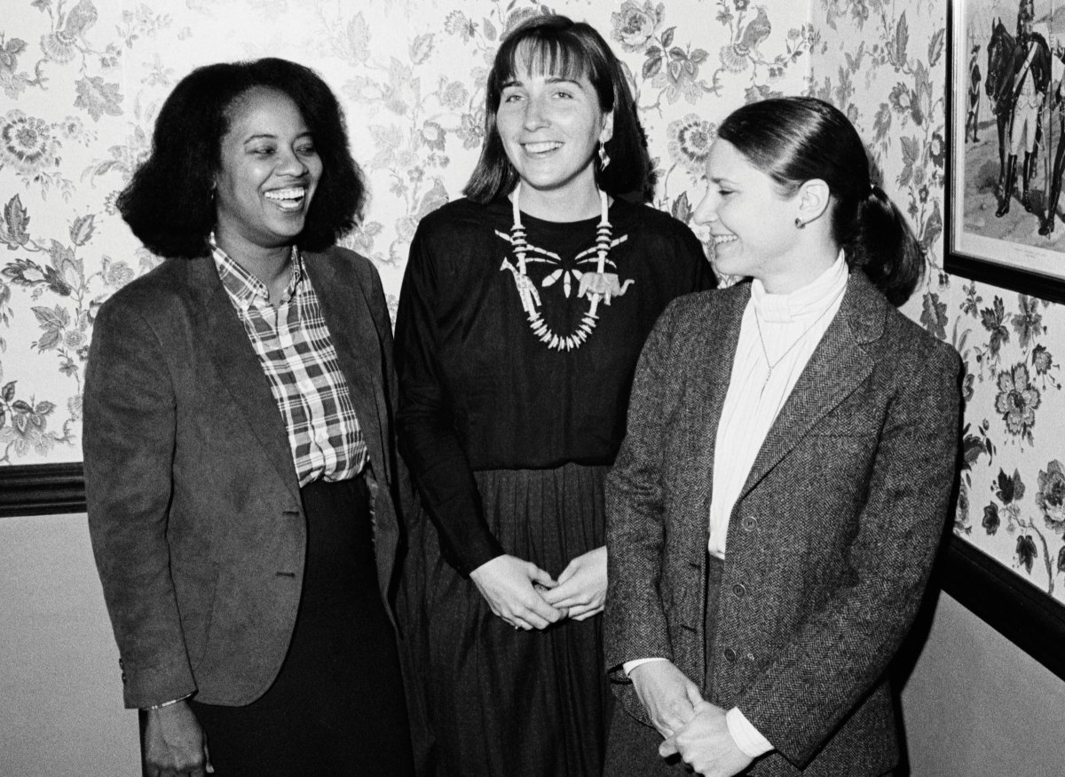 Mildred Ravenell (now Robinson), left, and Julie Roin, right, with an unidentified student