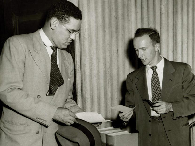Swanson consults with Assistant Law Dean Charles Woltz