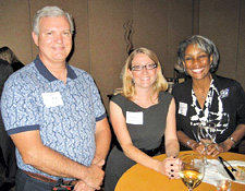 Bob Wilkens '83, Laura Everett '02 and Markita Cooper '82