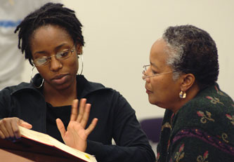 Gigi Parris and Mildred Robinson speak during class