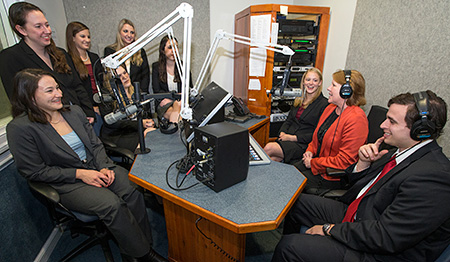 Innocence Project Clinic at UVA Law students and Deirdre Enright, second from right, gather in the studio where an interview for the