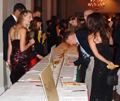 Students peruse the offerings of the silent auction.