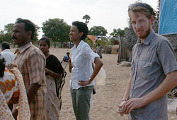 Meredith Horton and Ryan Harvey, tour a temporary settlement for displaced tsunami victims.