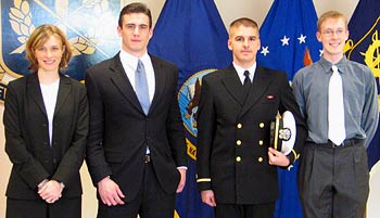 From left, Ensigns Erin Quay, Craig Warner, and Christopher Colby, and future Air Force JAG Corps member Brian Green.