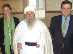 Erin Houlihan '11,  left, in Iraq with Osama Al-Nujaifi, the speaker of the Iraqi  Parliament, and William Spencer, right.