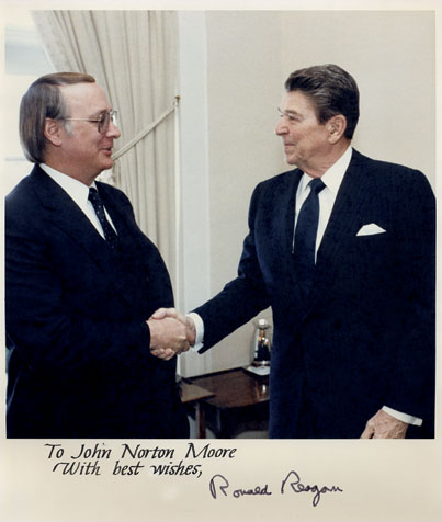 John Norton Moore shakes hands with President Ronald Reagan