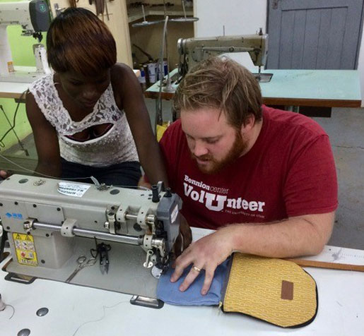 Second-year student Jeremy Lofthouse, right, learns to sew a handbag