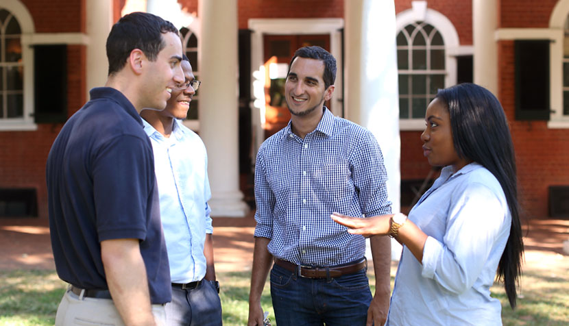 UVA Law students and Tri-Sector fellows Alex Hoffarth '18, Gannam Rifkah '17 and Charis Redmond '17 talk with Darden student and fellow Dana Adams, second from left.