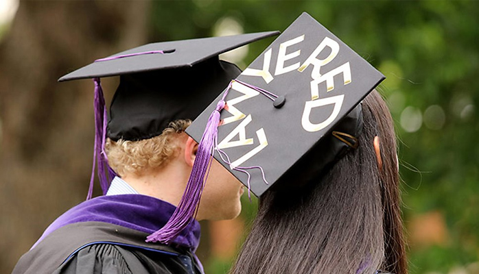 "Student with ""Lawyered"" written on mortarboard"